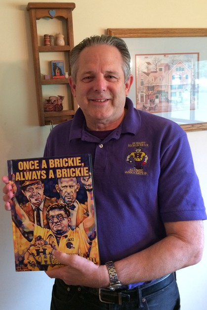 "Paul Addison holding ""Once a Brickie, Always a Brickie"""